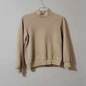 Alfred Dunner tan diamond patterned sweater.